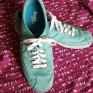 Keds sport lace up tennis shoes.